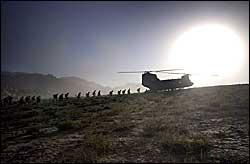 Soldiers from the 10th Mountain Division load into a Chinook helicopter atop a ridge in Oruzgan, Afghanistan. The unit patrols mountains near a U.S. outpost in Shkin. Photographs by David Swanson / Inquirer.